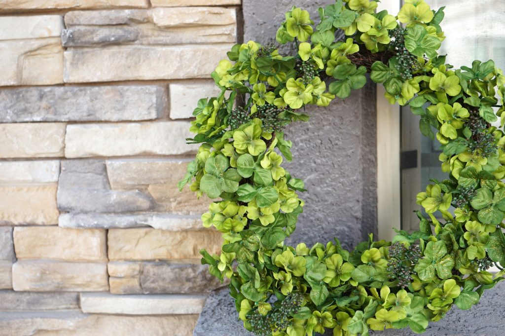 shot of green wreath outside of the house