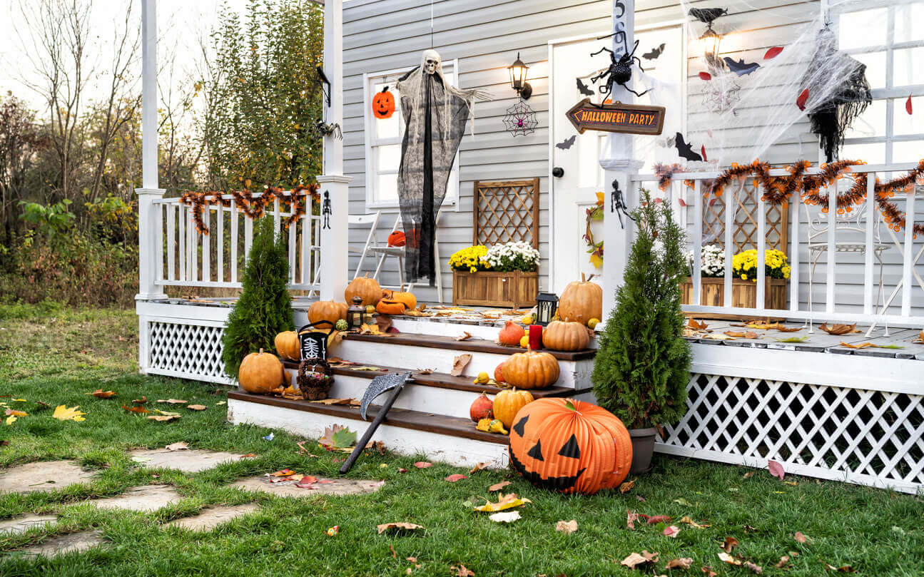 Halloween Jack-o-Lantern Pumpkins on a porch stairs